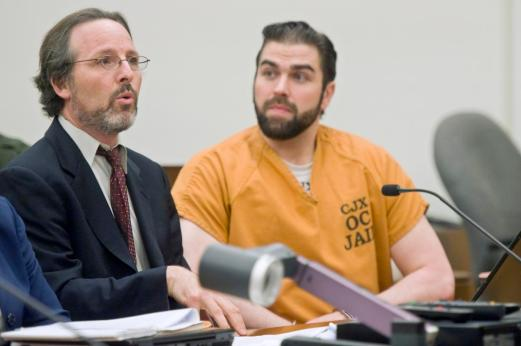 Deputy public defender Scott Sanders, left, speaks during a hearing on behalf of his client, Daniel Wozniak at the Orange County Central Justice Center in Santa Ana on Friday. ///ADDITIONAL INFO: OCR.WOZNIAK.0926 - 9/25/15 - PHOTO BY JOSHUA SUDOCK, STAFF PHOTOGRAPHER - Attorneys spent Friday morning arguing a before superior court judge, Gregg L. Picket, in an effort to determine whether another judge, John Conley, should testify as a witness in a case he is currently presiding over, People v. Daniel Wozniak. Defense attorney Scott Sanders believes the judge should be allowed to take the stand on grounds that, prior to becoming a judge, he may have participated in early incarnations of the county's confidential jailhouse informant program which, Sanders asserts, was instrumental in convicting his client. Picture made at the Orange County Central Justice Center (dept. C41) in Santa Ana, California on Thursday, September 24, 2015.